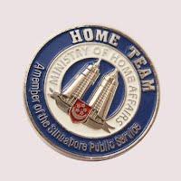 Silver tower metal badge