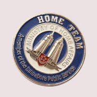 Silver tower metal badge